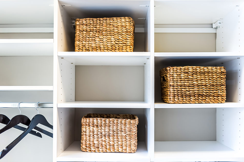 Basket organizers in closet, clean and tidy space