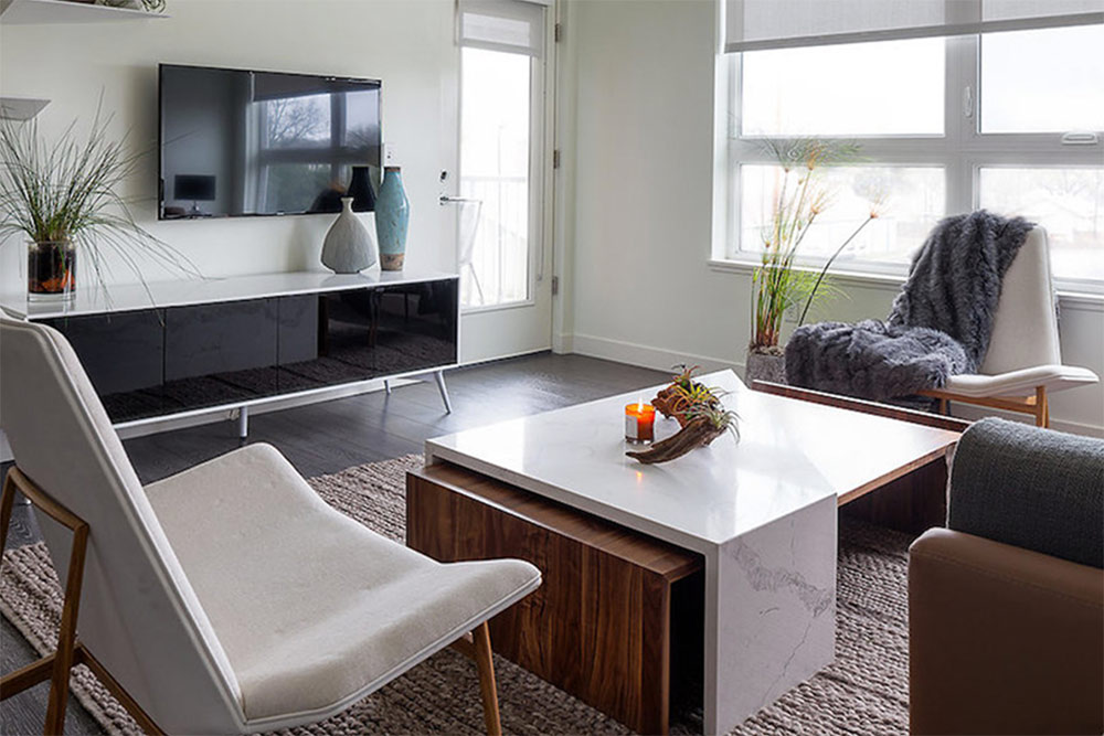 Beautiful, minimalist styled living room at Woodside Village, luxury apartments in Westwood
